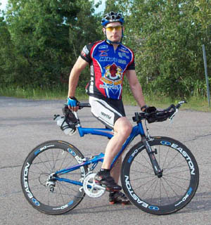 hot looking dude on high tech road bike, training on Ile Notre-Dame's Formula 1 racing circuit in Montreal